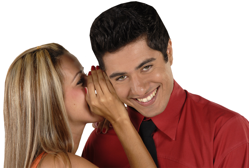 woman wispering in man's ear