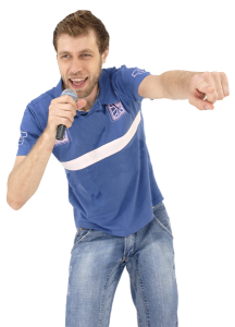 man with microphone pumping fist