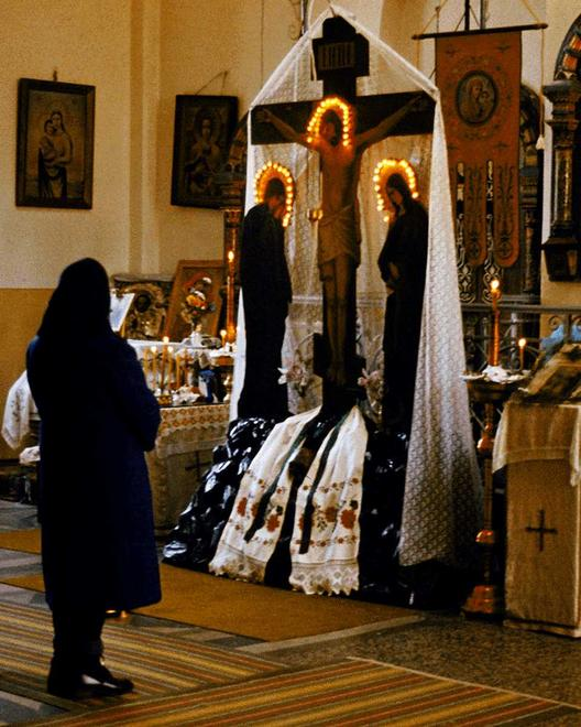 Woman before altar