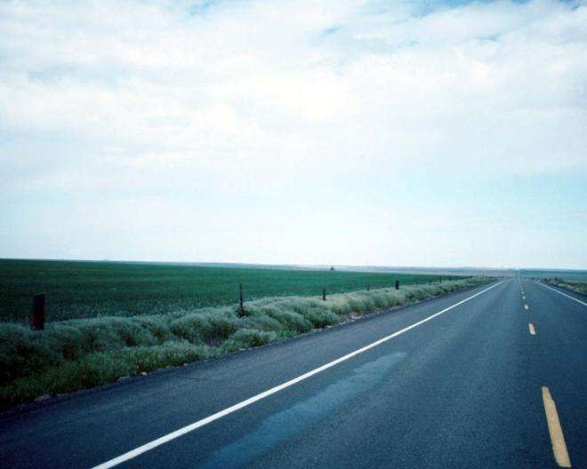 Empty highway along countryside