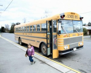 Child leaving bus for school