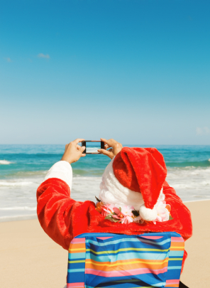 Santa Clause taking pictures on beach