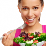 fit woman eating salad