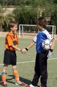 kids shaking hands before football match