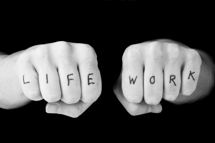 fists wih life and work written on fingers
