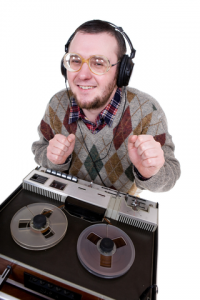 nerdy dressed man enjoying music