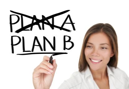 woman writing PLAN B on clear board