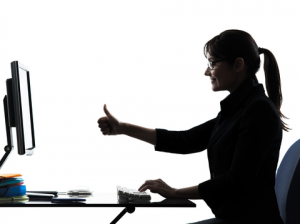 woman in front of computer giving thumbs up sign