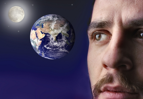 Man looking at earth concept