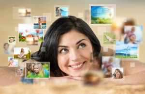 Woman laying with lots of images around her